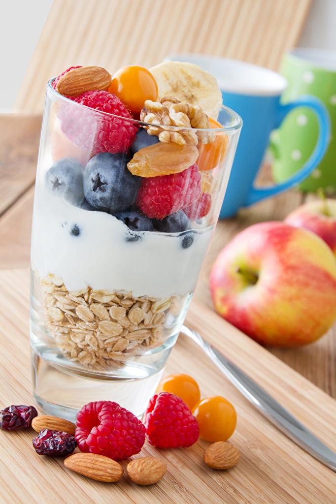 Фото Стакан Яблоки Малина Мюсли Продукты питания Орехи стакана стакане Еда Пища
