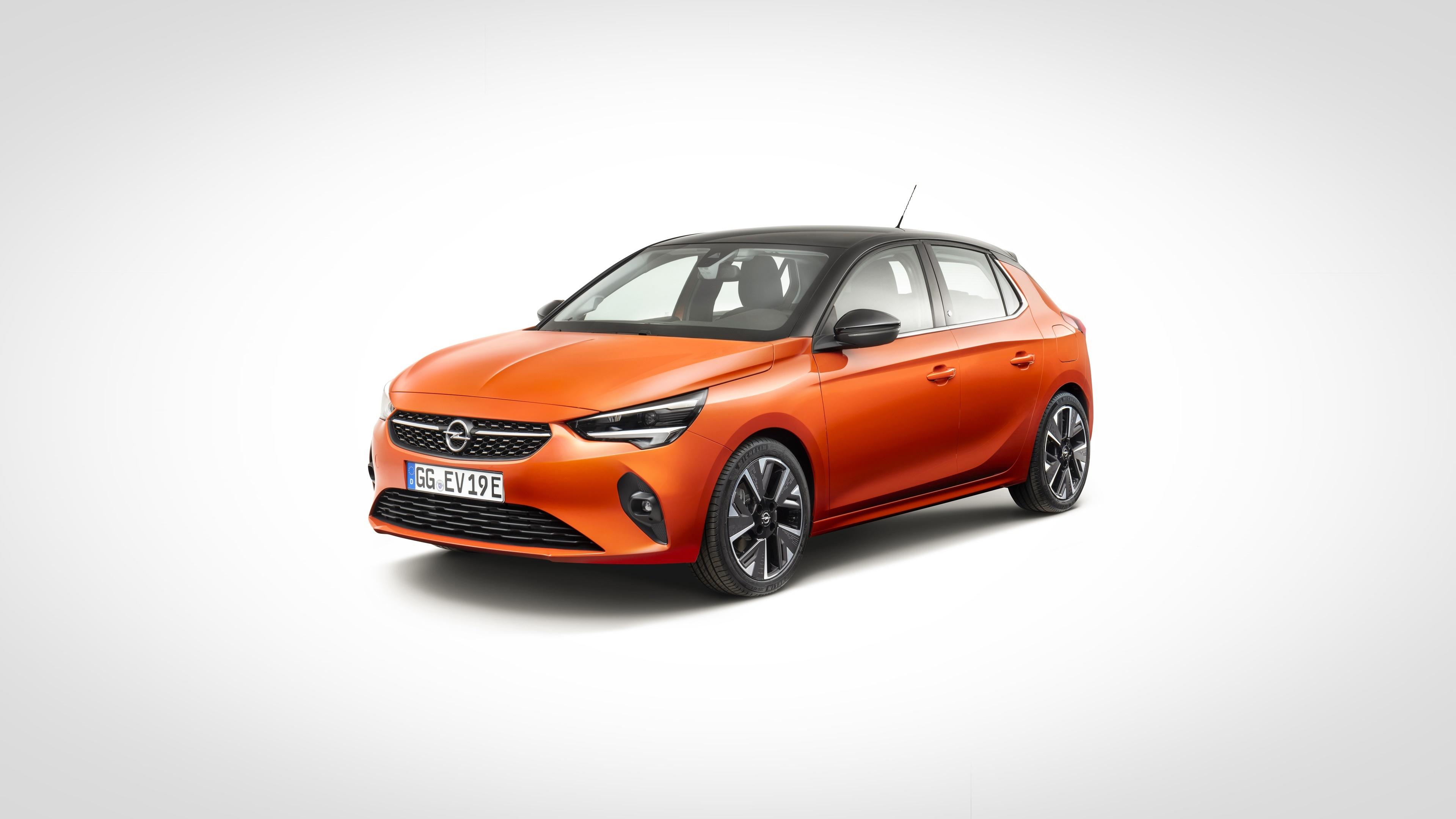Фотография Opel Corsa, 2020 оранжевых Металлик Автомобили Серый фон Опель Оранжевый оранжевые оранжевая авто машина машины автомобиль сером фоне