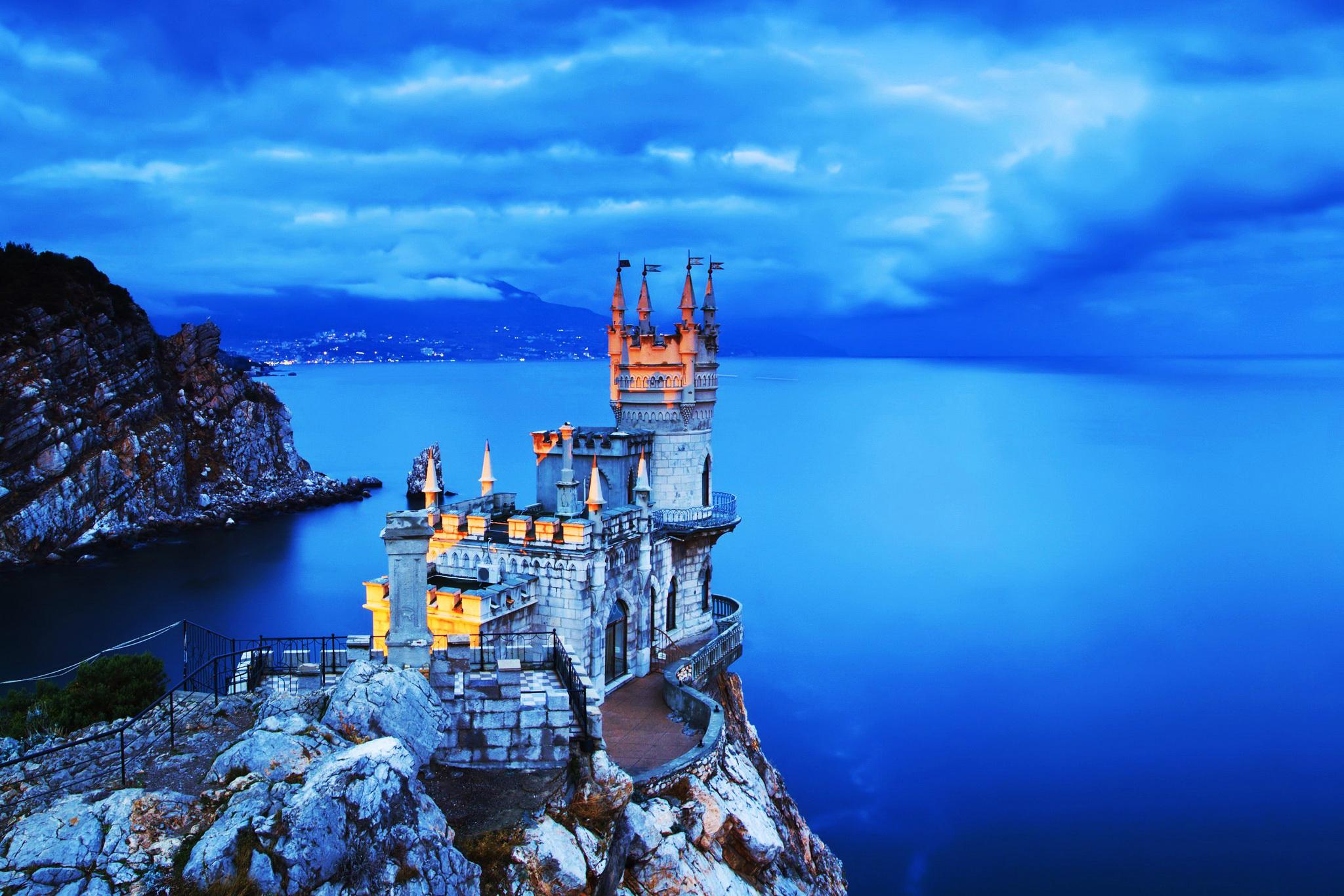 замок на морском закате без смс