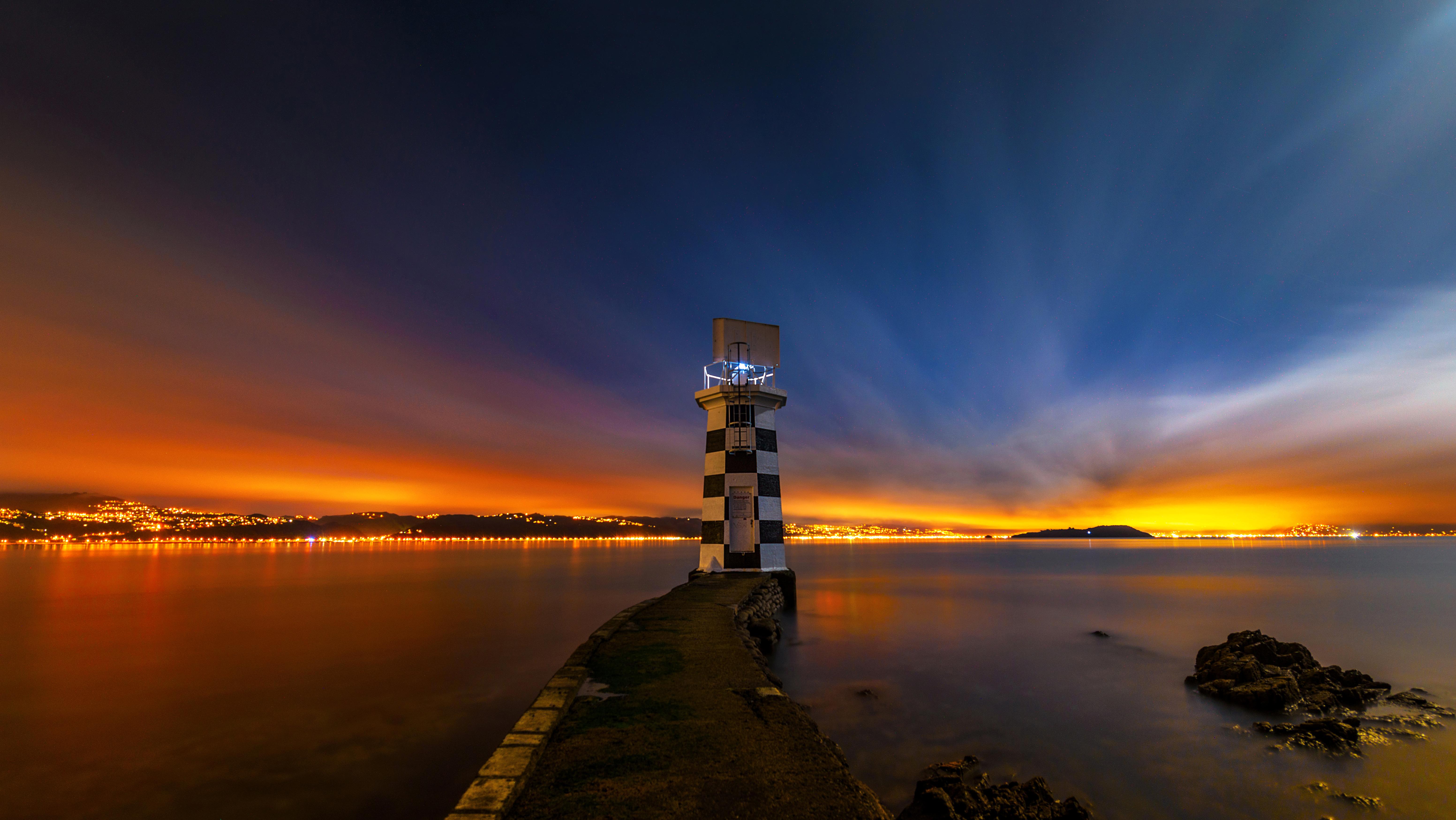 Фото Новая Зеландия Wellington Маяки Природа рассвет и закат Ночные 6210x3500 маяк Рассветы и закаты Ночь ночью в ночи