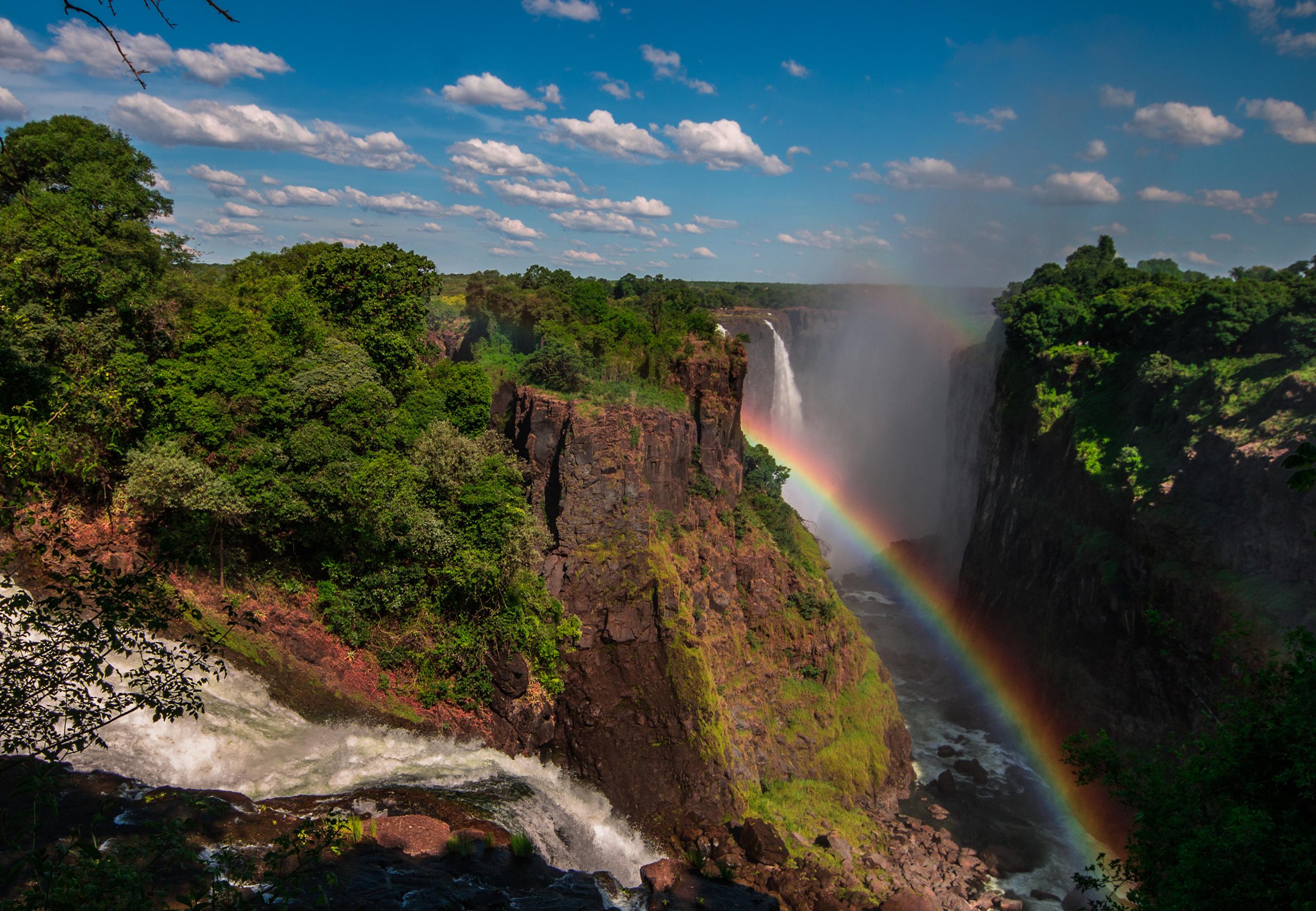 Фото Victoria Falls Zimbabwe Скала Радуга Природа Водопады кустов Утес скале скалы радуги Кусты