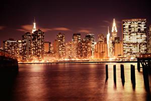 Фото США Здания Небоскребы Побережье Нью-Йорк Ночью Мегаполис Manhattan  город