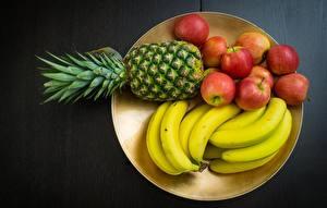 Фотографии Фрукты Ананасы Бананы Яблоки Тарелка Продукты питания