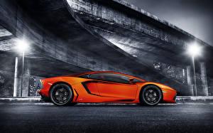 Фотографии Lamborghini Оранжевые Сбоку Роскошные aventador lp700-4 Автомобили
