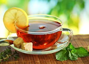 Фотография Напитки Чай Лимоны Чашке Блюдце Еда