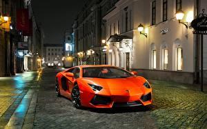 Фото Ламборгини Оранжевый Спереди Дорогие Улица Aventador LP700-4 Авто