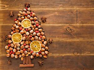 Фотография Фрукты Цитрусовые Орехи Новый год Елка Еда