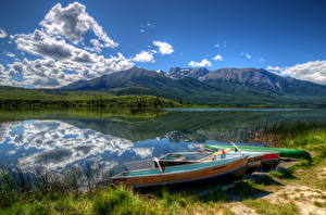 Картинка Канада Парки Озеро Лодки Горы Пейзаж Небо Трава Джаспер парк Talbot Природа