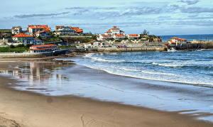 Фотографии Испания Море Побережье Здания Песка Пляжи Comillas Cantabria Города Природа