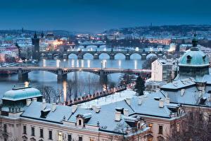 Картинка Чехия Прага Здания Реки Мосты Зима Карлов мост Ночь город