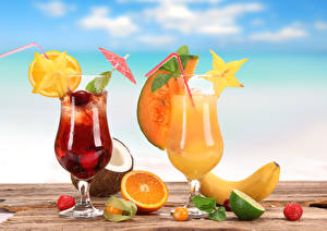 Картинки Напитки Сок Бананы Апельсин Кокосы Клубника Коктейль Бокалы Еда
