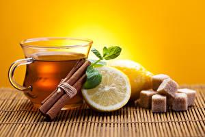 Картинка Напиток Чай Лимоны Крупным планом Корица Продукты питания