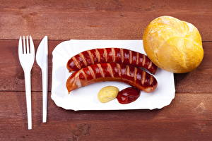 Обои Мясные продукты Колбаса Булочки Нож Кетчуп Вилка столовая Еда
