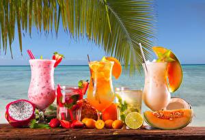 Картинка Напитки Коктейль Дыни Апельсин Лимоны Клубника Бокал Еда