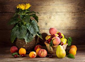 Фотографии Фрукты Персики Вишня Подсолнухи Груши Продукты питания