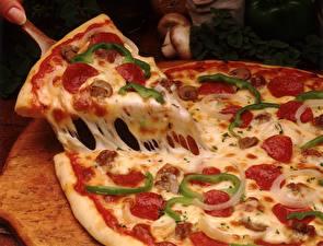 Фотографии Пицца Крупным планом Сыры Кусок Еда