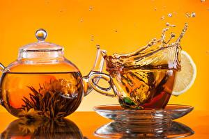 Картинка Напитки Чай Лимоны С брызгами Чашка Блюдца Еда