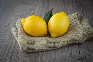 Фото Цитрусовые Лимоны Двое