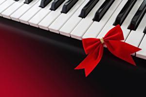 Картинки Праздники Музыкальные инструменты Бантик Пианино