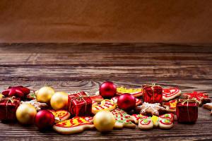Обои Праздники Новый год Печенье Шарики Подарки фото