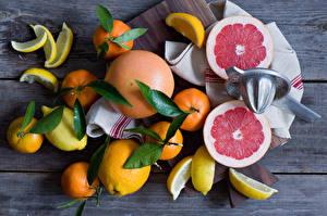 Картинки Фрукты Апельсин Лимоны Мандарины Еда
