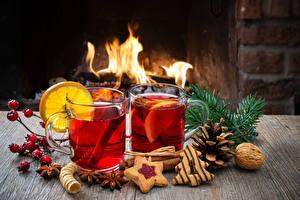 Обои Праздники Новый год Напитки Чай Лимоны Печенье Орехи Огонь Стакан Еда фото