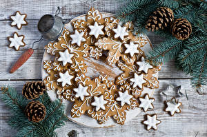 Обои Праздники Новый год Выпечка Печенье Ветки Шишки Еда фото