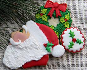 Обои Праздники Новый год Печенье Дед Мороз Еда
