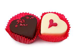 Фотографии Сладкая еда Конфеты Шоколад Двое Еда