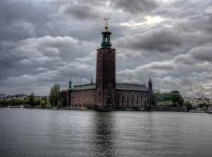 Картинка Швеция Здания Речка Небо Стокгольм Town Hall Города