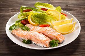 Обои Морепродукты Рыба Лимоны Тарелка Еда фото
