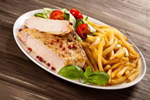 Фотография Мясные продукты Картофель фри Овощи Тарелке Еда