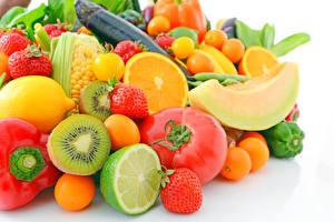 Фотография Фрукты Овощи Помидоры Киви Дыни Клубника Апельсин Лимоны Лайм Пища