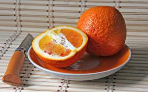 Фото Апельсин Нож Фрукты Вблизи Тарелка Продукты питания