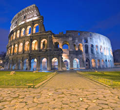 Фотографии Италия Развалины Дороги Небо Колизей Рим Газон Арка Природа