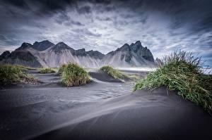 Картинки Исландия Гора Облака Песок Пляж Reynisfjara Природа