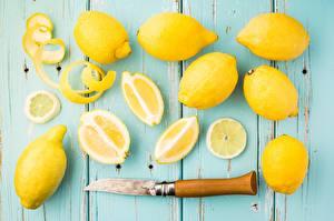Обои Лимоны Ножик Крупным планом Фрукты Желтая Еда