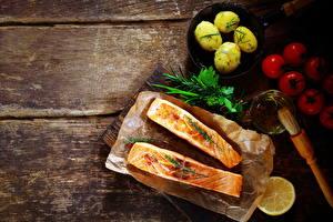 Фотография Морепродукты Рыба Картофель Помидоры Еда