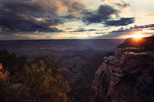Картинки Парки США Рассвет и закат Небо Каньоны Скалы Облачно arizona Природа