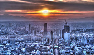 Картинки Япония Здания Небоскребы Рассвет и закат Горы Токио Мегаполис Солнца город