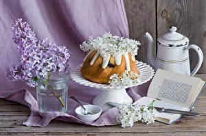 Фото Выпечка Сирень Кувшины Банка Книги Пища Цветы