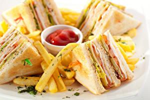 Фото Фастфуд Бутерброды Картофель фри Сэндвич Кетчупом Продукты питания