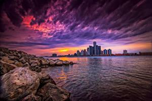 Картинка Штаты Небоскребы Камень Рассвет и закат Небо Здания Река Detroit город Природа