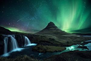 Фотографии Исландия Небо Горы Водопады Звезды Киркьюфетль гора Вулканы В ночи Полярное сияние Природа