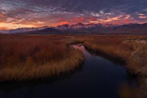 Фотография Речка Горы Рассветы и закаты Небо Трава Природа