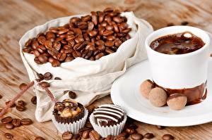 Картинка Шоколад Кофе Конфеты Крупным планом Напиток Зерно Чашке Блюдца Пища