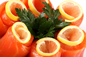 Картинки Морепродукты Рыба Лимоны