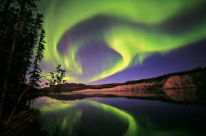 Фотографии Канада Небо Полярное сияние Ночные Aurora Borealis Yukon Природа