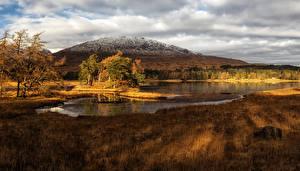 Фотографии Пейзаж Шотландия Горы Озеро Небо Траве lake Tulla Природа