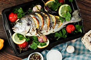 Фотографии Морепродукты Рыба Лимоны Томаты